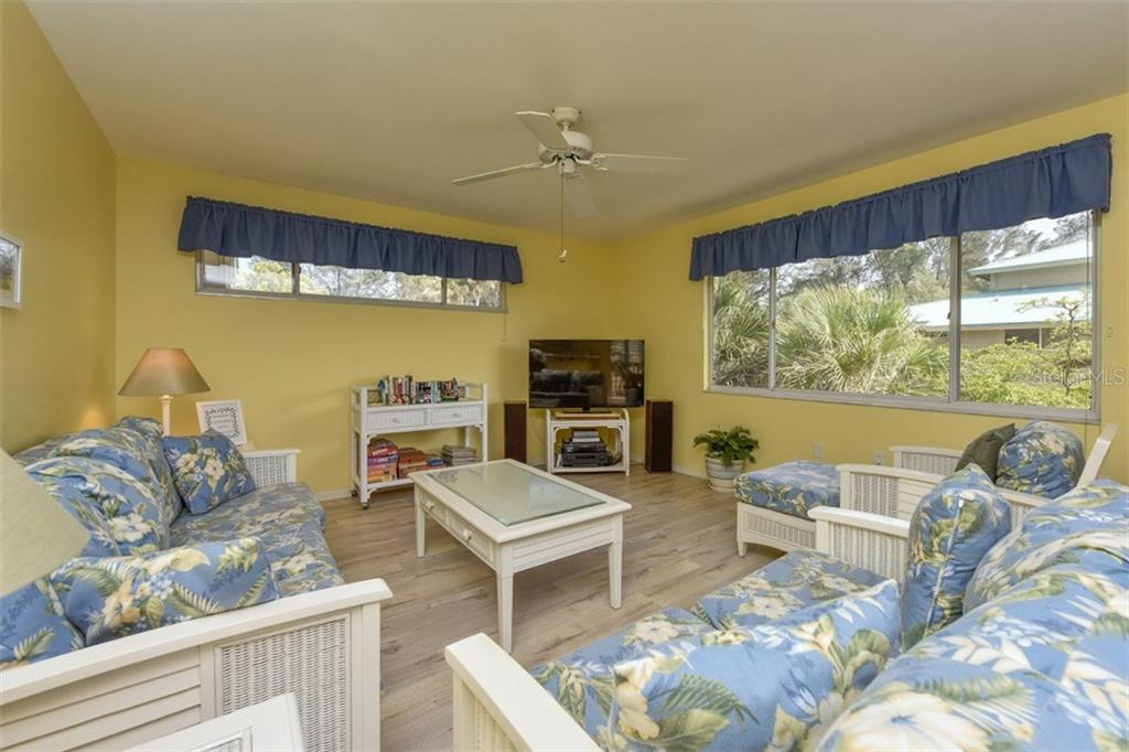 Living room - Condo for sale at 9200 Little Gasparilla Is #201, Placida, FL 33946 - MLS Number is D5909647