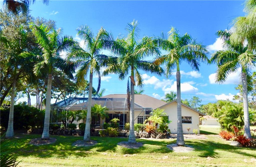 TASTEFUL LANDSCAPING WITH AMAZING PALM TREES VIEWED FROM THE GOLF COURSE INTO THE POOL/LANAI.... PLEASE MAKE AN APPOINTMENT TO VIEW THIS MAJESTIC TURNKEY FLORIDA DREAM HOME - Single Family Home for sale at 44 Pinehurst Pl, Rotonda West, FL 33947 - MLS Number is D5915271