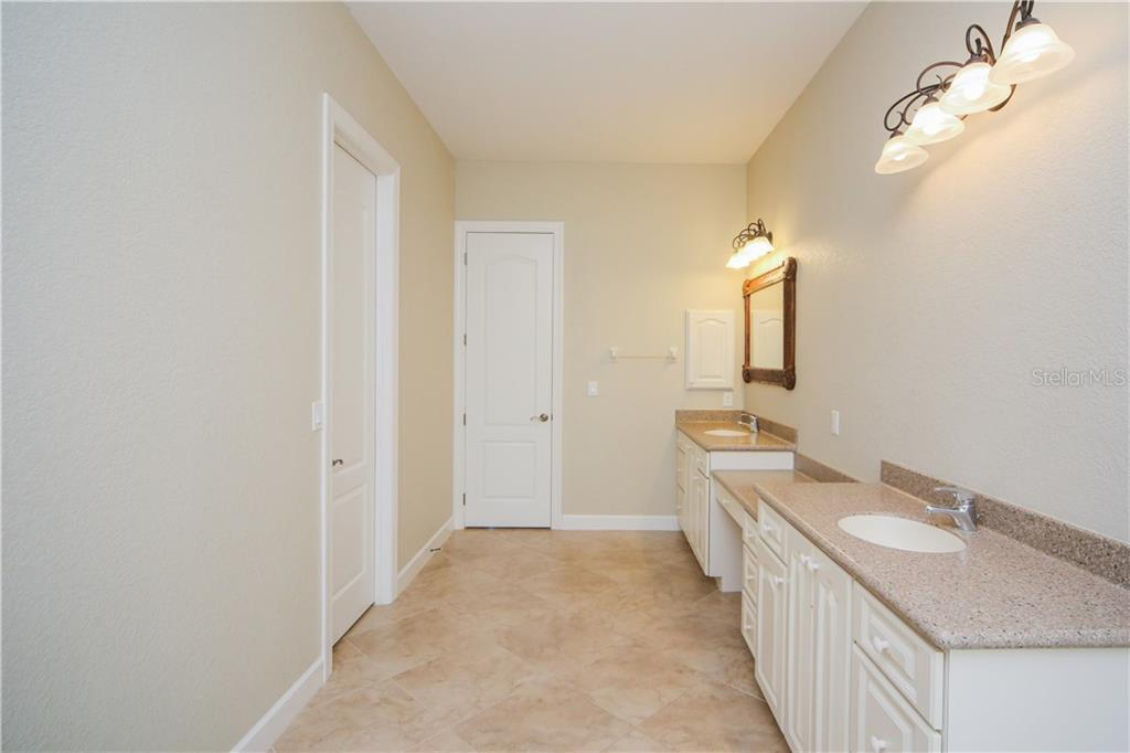 en Suite Bath with double vanities - Single Family Home for sale at 550 Coral Creek Dr, Placida, FL 33946 - MLS Number is D5917129