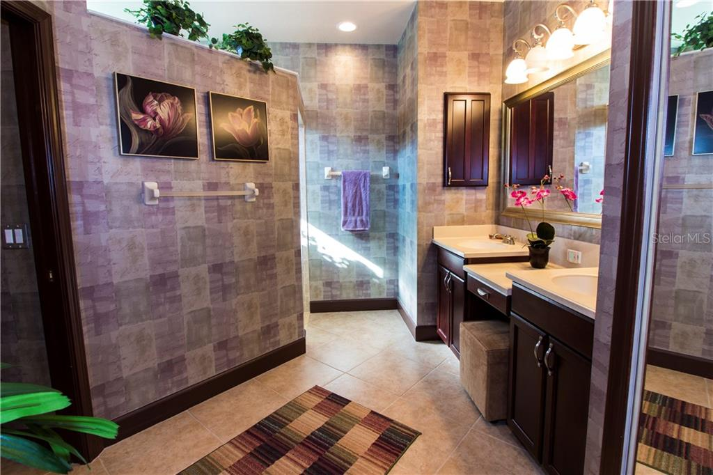Large master bathroom with double sinks - Single Family Home for sale at 1855 Batello Dr, Venice, FL 34292 - MLS Number is D5917776