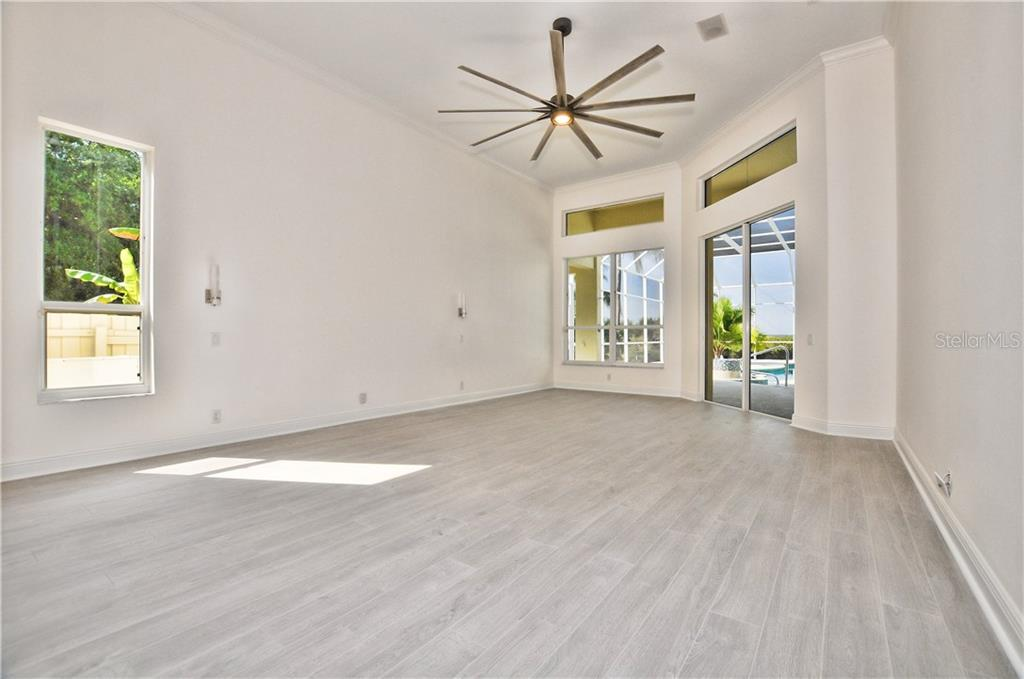 Nice pool area with a view of all the sliders that open into the formal living room family room and master bedroom. - Single Family Home for sale at 3121 Rivershore Ln, Port Charlotte, FL 33953 - MLS Number is D5917816