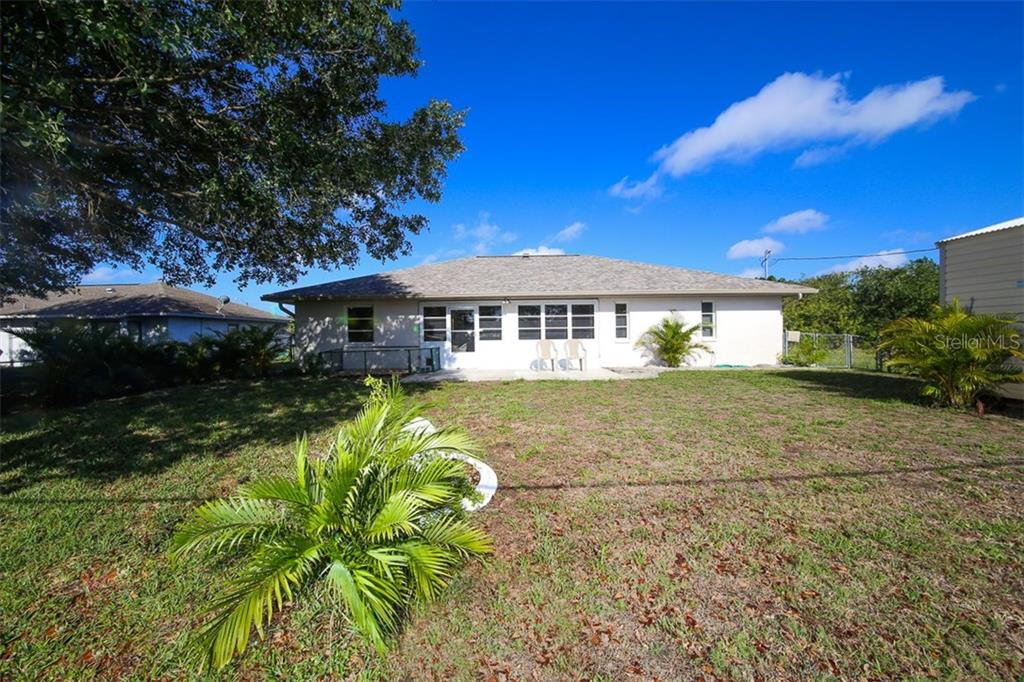 Rear - Single Family Home for sale at 7044 Quigley St, Englewood, FL 34224 - MLS Number is D5918526
