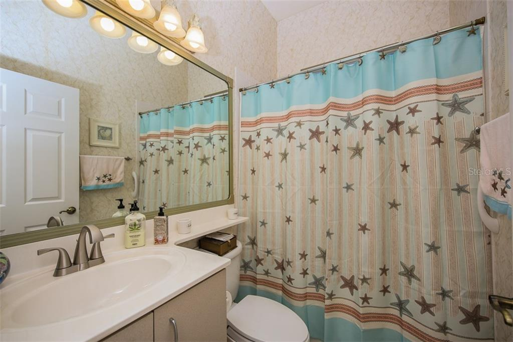 Second Bathroom - Single Family Home for sale at 5660 Riviera Ct, North Port, FL 34287 - MLS Number is D5919107