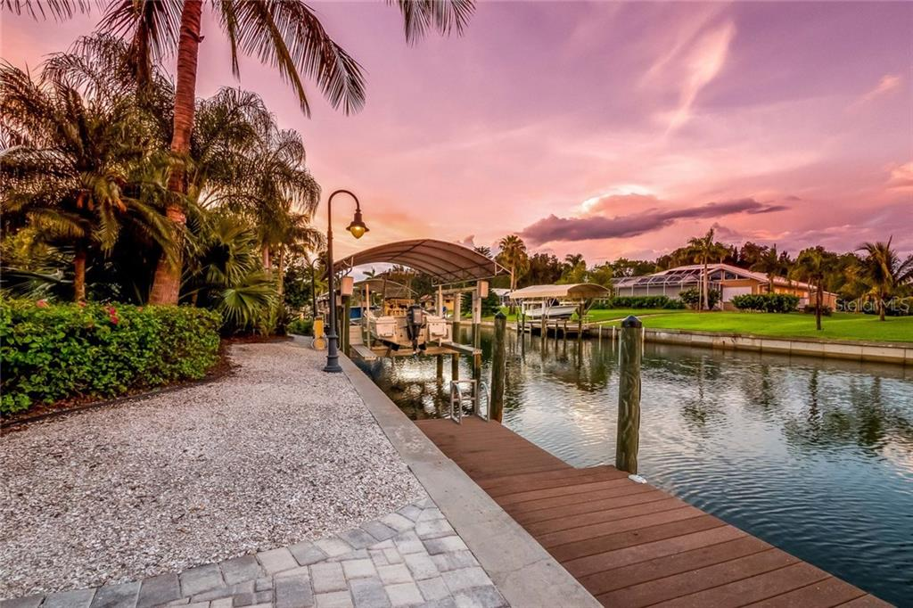 Canal and covered boat lift - Single Family Home for sale at 260 Capstan Dr, Cape Haze, FL 33946 - MLS Number is D5919159