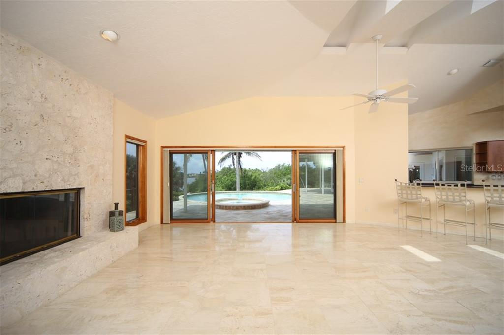 Great Room/Coral Fireplace & Full Bar - Single Family Home for sale at 1850 Bayshore Dr, Englewood, FL 34223 - MLS Number is D5919513