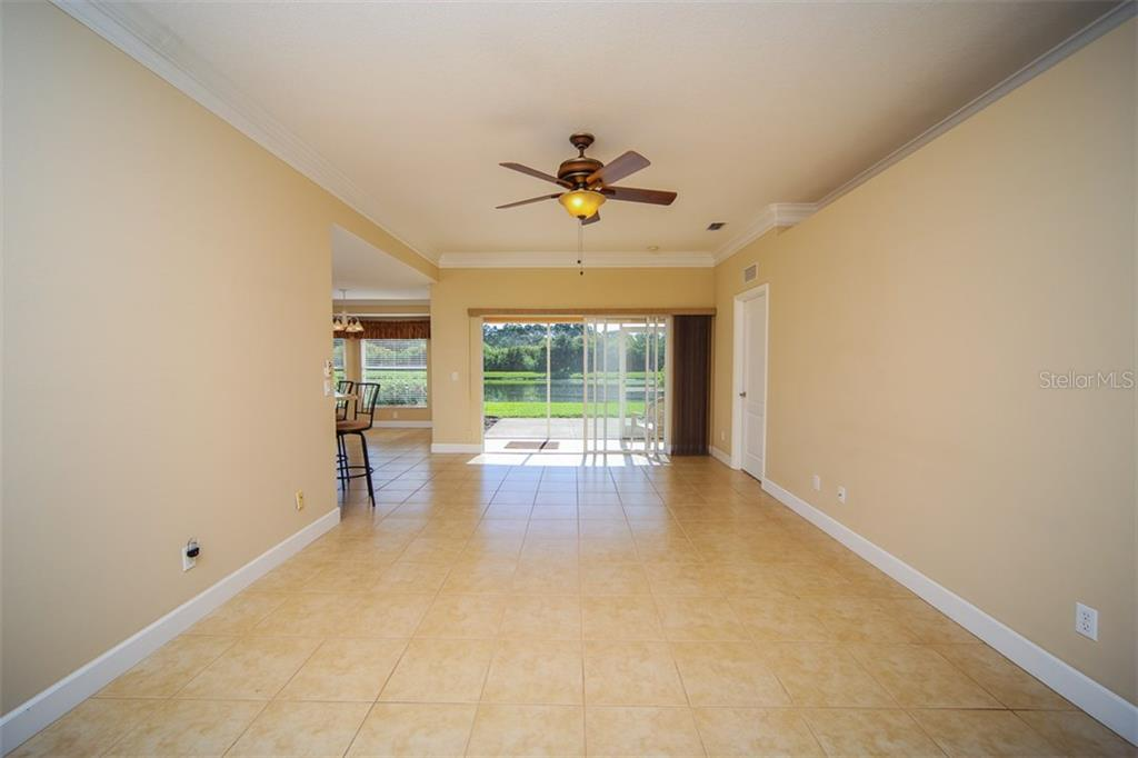 Bright home wth beautiful pond view - Single Family Home for sale at 414 Tomoka Dr, Englewood, FL 34223 - MLS Number is D5919831
