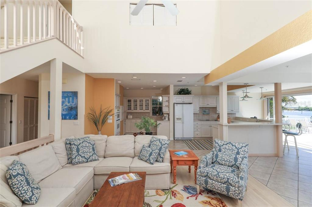 Open floor plan with sweeping views of pool, Gasparilla Sound and Charlotte Harbor - Single Family Home for sale at 16740 Grande Quay Dr, Boca Grande, FL 33921 - MLS Number is D5920860