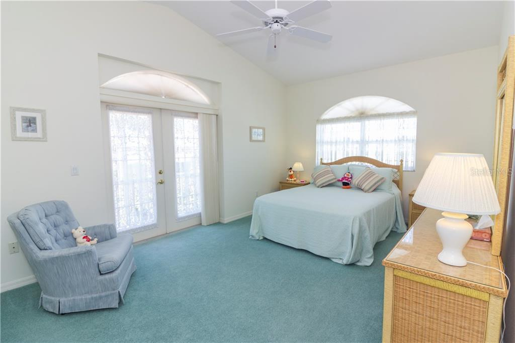 This front bedrooms is the one with the balcony seen in the first picture. - Single Family Home for sale at 1439 Deer Creek Dr, Englewood, FL 34223 - MLS Number is D5921060