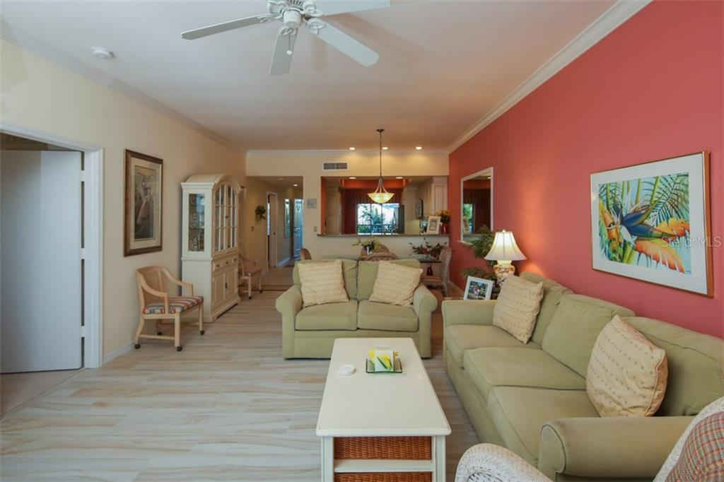 Living Room-Dining Room-Kitchen - Condo for sale at 11000 Placida Rd #309, Placida, FL 33946 - MLS Number is D5921681