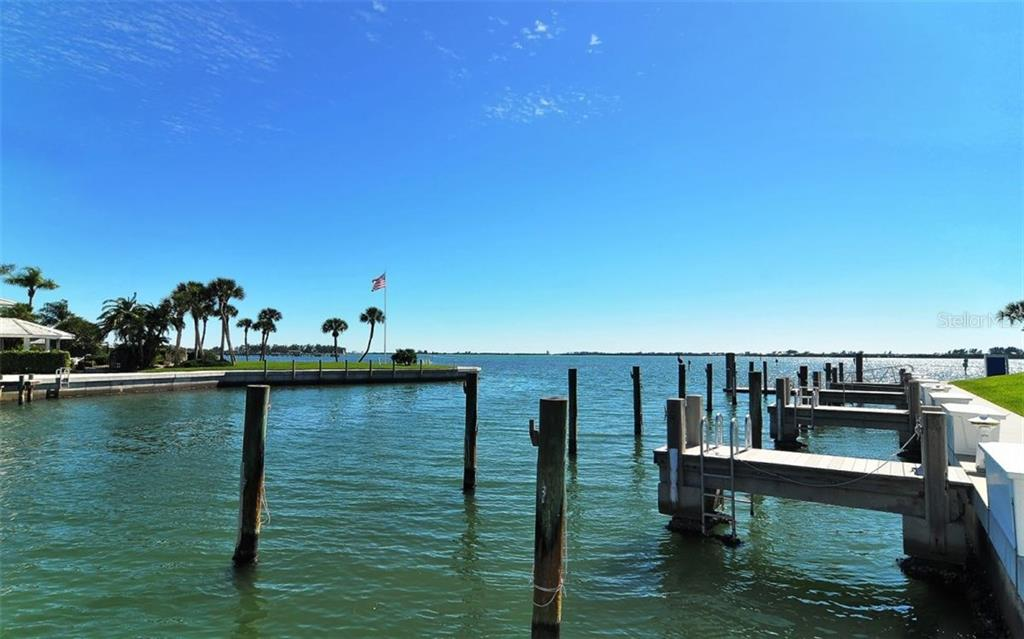 Boat slips just off the Intracoastal Waterway may be leased by Club members. - Condo for sale at 11000 Placida Rd #1303, Placida, FL 33946 - MLS Number is D5921767