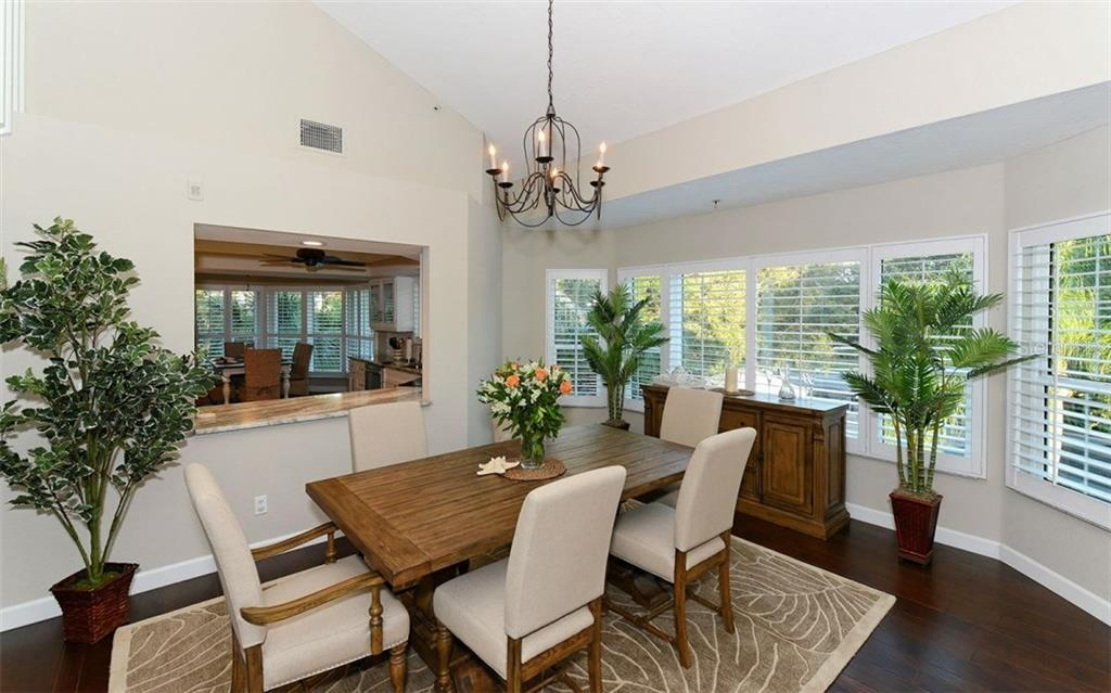 Dining Room affords an oversized kitchen pass-through and sunny bay windows. - Condo for sale at 11000 Placida Rd #1303, Placida, FL 33946 - MLS Number is D5921767