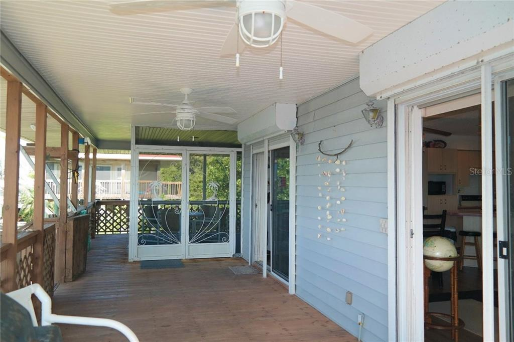 Front porch and screened in lanai. - Single Family Home for sale at 8384 Little Gasparilla Is, Placida, FL 33946 - MLS Number is D5922085