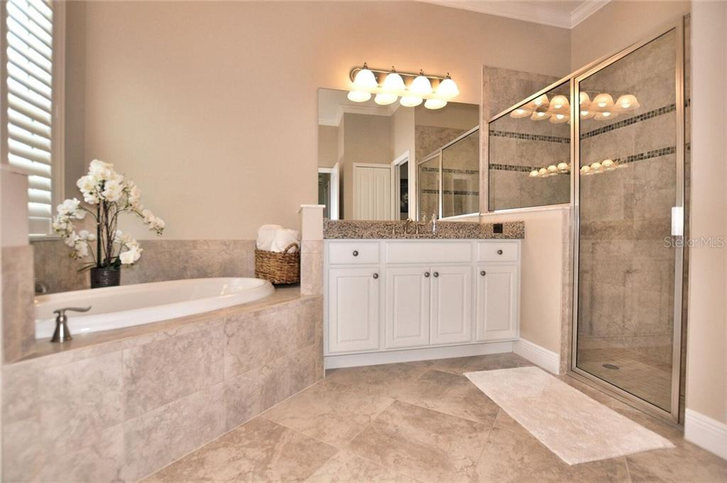 Master bathroom with separate tub/shower - Single Family Home for sale at 8944 Scallop Way, Placida, FL 33946 - MLS Number is D5923173