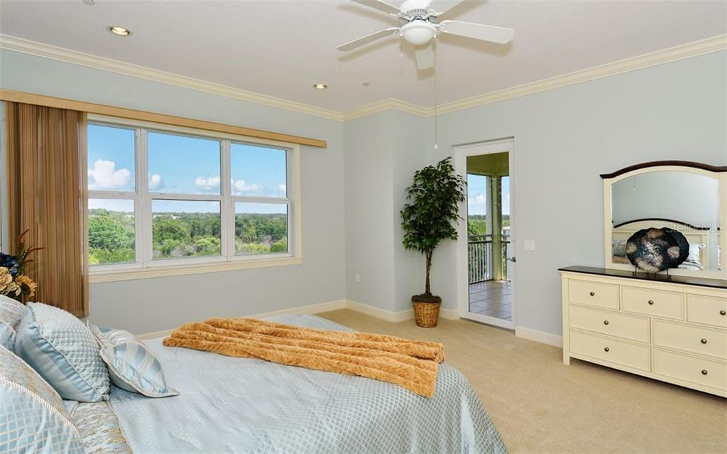 Spacious Master Bedroom that opens to Lanai - Condo for sale at 8561 Amberjack Cir #402, Englewood, FL 34224 - MLS Number is D5923600