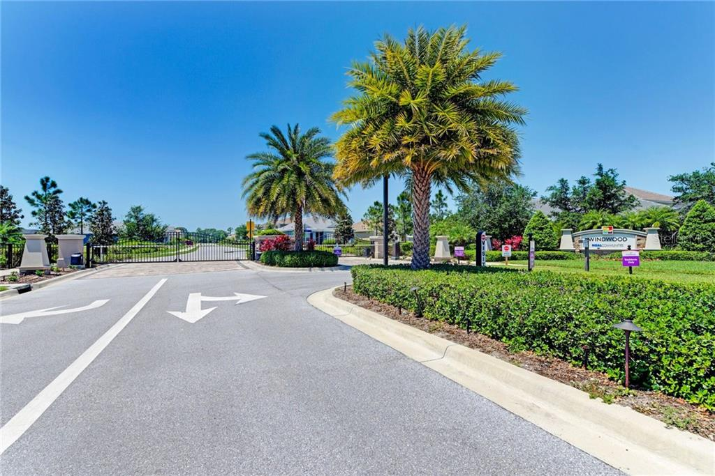 Gated entrance to Windwood provides security while you are home or away. - Single Family Home for sale at 141 Avens Dr, Nokomis, FL 34275 - MLS Number is D6100104