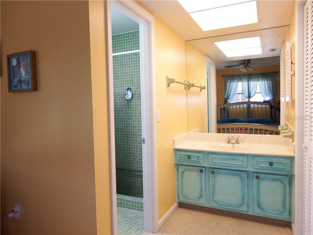 Master shower and new toilet.  Shower has new fixtures. - Single Family Home for sale at 12 Oakland Hills Pl, Rotonda West, FL 33947 - MLS Number is D6100794