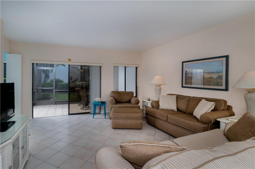 View from dining area toward living room and lanai - Condo for sale at 2955 N Beach Rd #b612, Englewood, FL 34223 - MLS Number is D6101147