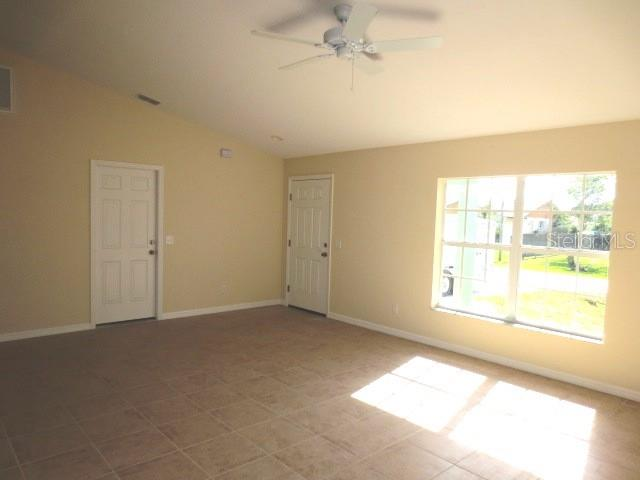 Master bedroom has tiled flooring, walk in closet and en suite bath - Single Family Home for sale at 7385 Teaberry St, Englewood, FL 34224 - MLS Number is D6101274