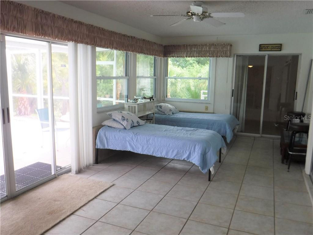 Bright sunroom has been used as sleeping quarters for the current owners. - Single Family Home for sale at 3001 Pellam Blvd, Port Charlotte, FL 33948 - MLS Number is D6101282