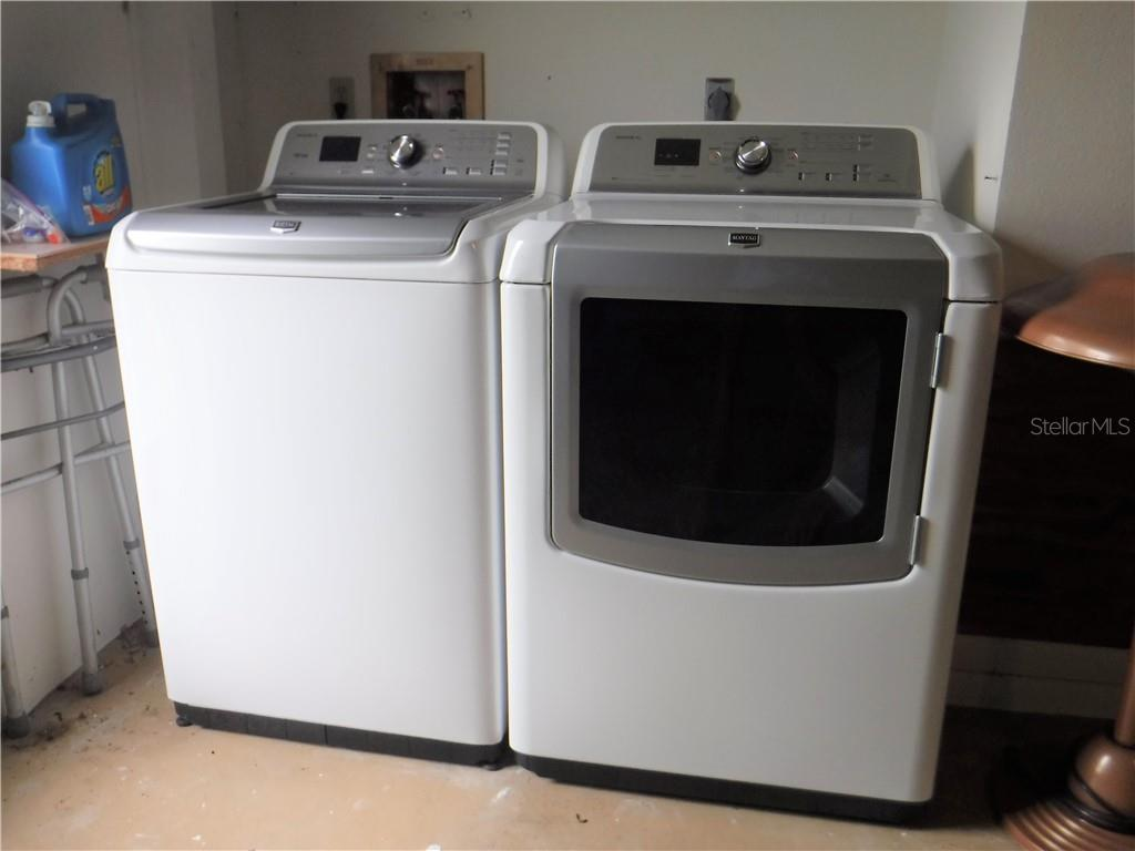 Newer washer and dryer in garage laundry center. - Single Family Home for sale at 3001 Pellam Blvd, Port Charlotte, FL 33948 - MLS Number is D6101282