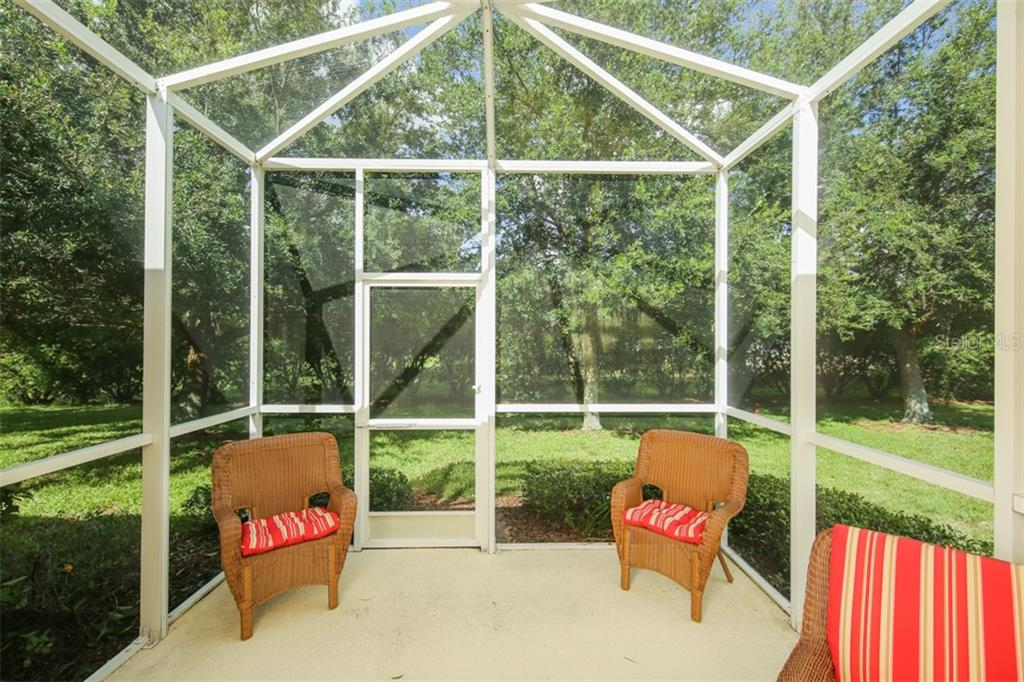 Plan to spend hours and days on your own lanai enjoying all the incredible weather Florida has to offer. Morning coffee is a must in this private space. And the SCREENED LANAI protects you from the Florida elements. - Villa for sale at 29704 Niagara Ct, Englewood, FL 34223 - MLS Number is D6102386