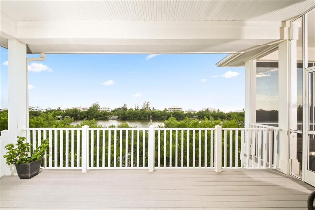 Second Floor Screened Lanai - Single Family Home for sale at 121 Bocilla Dr, Placida, FL 33946 - MLS Number is D6102584