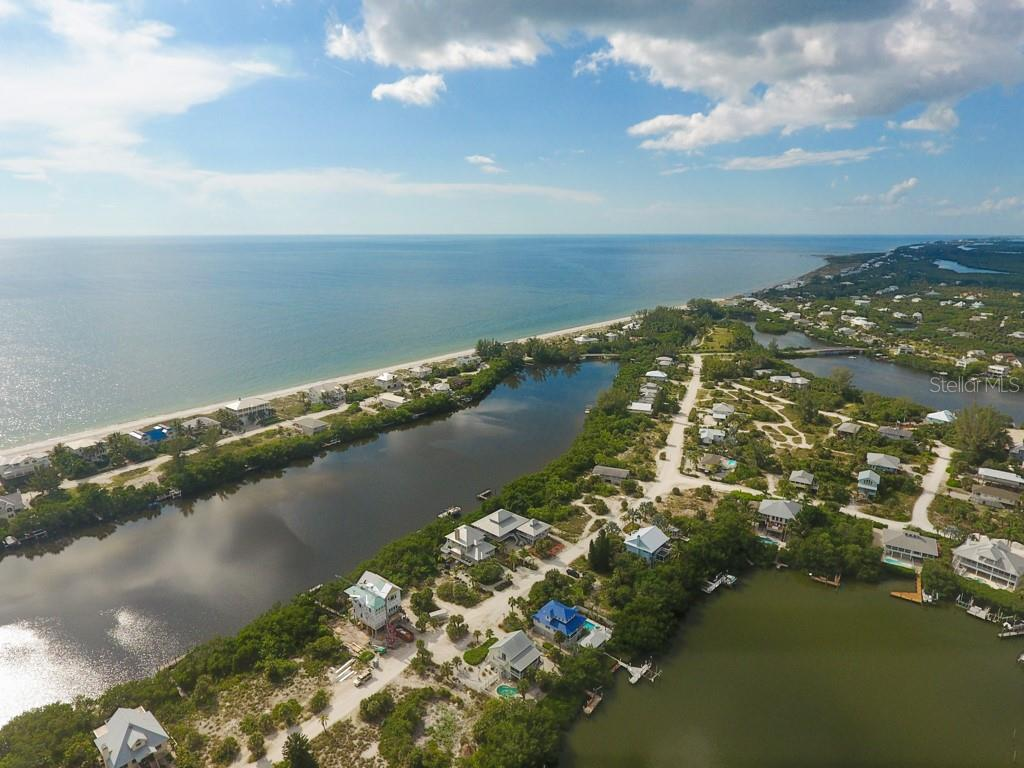Aerial Looking North - Single Family Home for sale at 121 Bocilla Dr, Placida, FL 33946 - MLS Number is D6102584