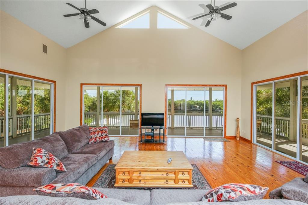 porch off of master bedroom - Single Family Home for sale at 534 N Gulf Blvd, Placida, FL 33946 - MLS Number is D6102654