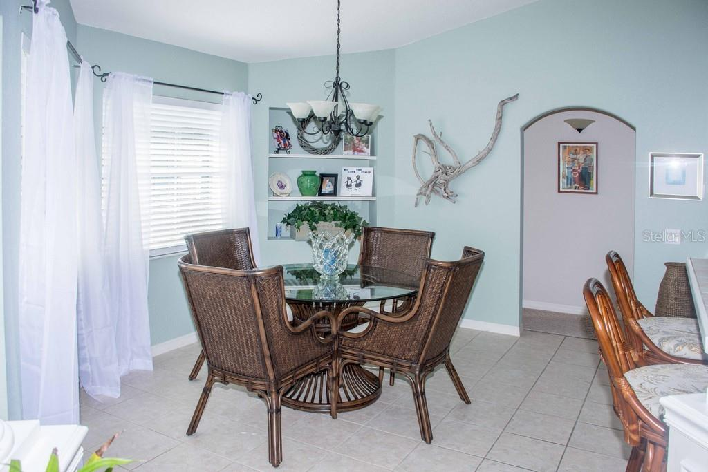 Dining area off the kitchen.  New dinette set. - Single Family Home for sale at 14 Long Meadow Ln, Rotonda West, FL 33947 - MLS Number is D6102683