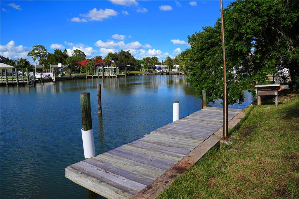 Dock view - Single Family Home for sale at 506 Pine Cone Ln, Nokomis, FL 34275 - MLS Number is D6102959