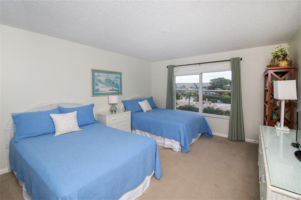 Guest bedroom with 2 double beds - Condo for sale at 6001 Boca Grande Cswy #e58, Boca Grande, FL 33921 - MLS Number is D6103590