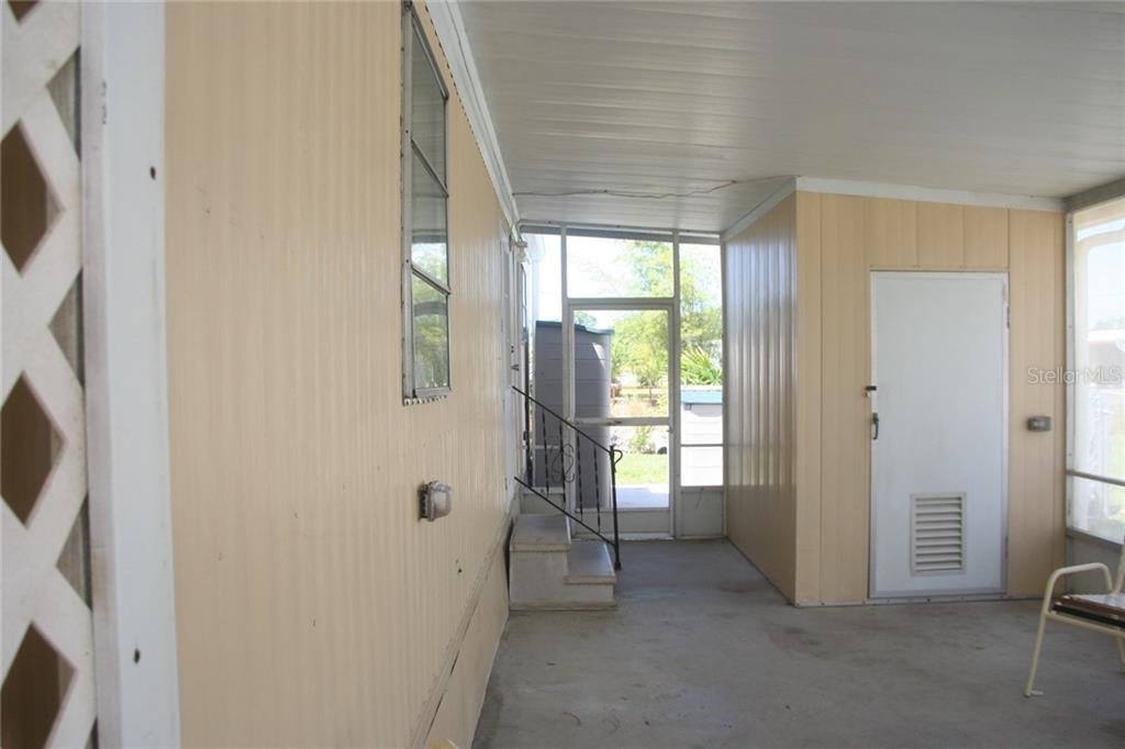 Screened Lanai is a great place to start your morning while you plan your day. - Manufactured Home for sale at 1316 Seagull Dr, Englewood, FL 34224 - MLS Number is D6105776