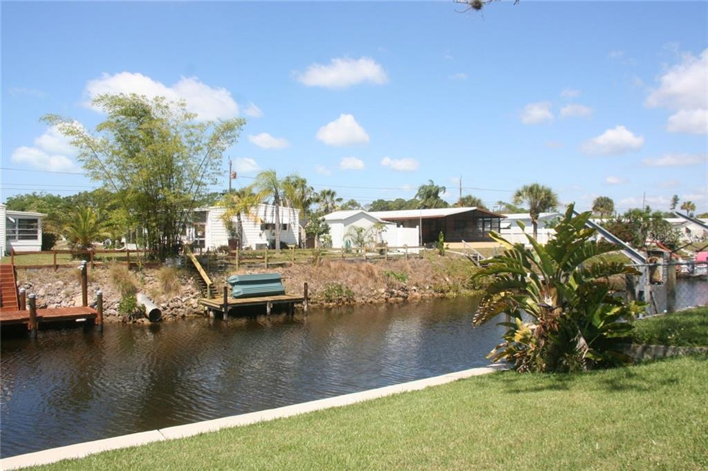 Backyard has a beautiful view of the water which has access to Lemon Bay. - Manufactured Home for sale at 1316 Seagull Dr, Englewood, FL 34224 - MLS Number is D6105776