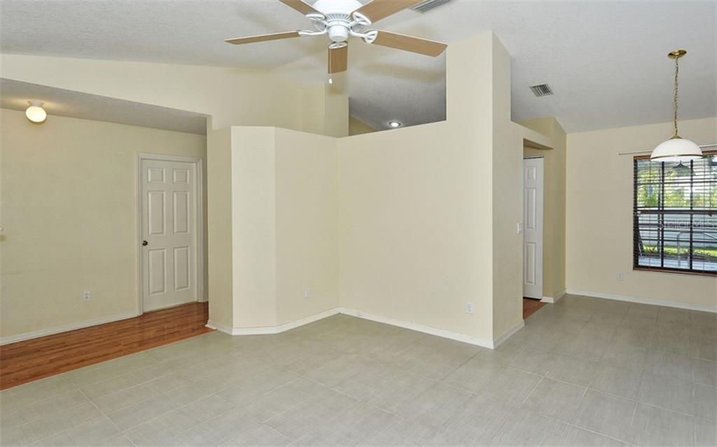 Entry hall and Living Room/Dining Area - Single Family Home for sale at 5376 Ashwood Rd, Port Charlotte, FL 33981 - MLS Number is D6105888