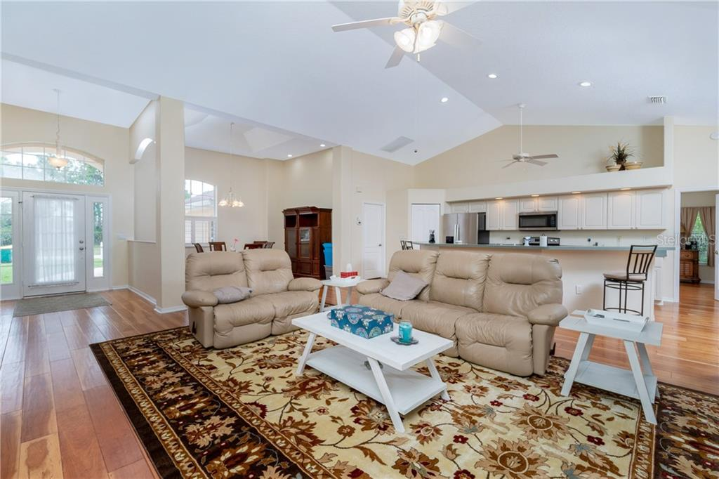 Large arched windows, high ceilings & the flow of the open floor plan creates an atmosphere of casual elegance. - Single Family Home for sale at 30 Medalist Way, Rotonda West, FL 33947 - MLS Number is D6106239
