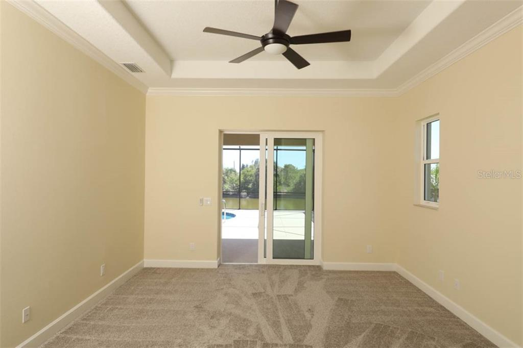 master opening to pool - Single Family Home for sale at 15586 Seafoam Cir, Port Charlotte, FL 33981 - MLS Number is D6106527