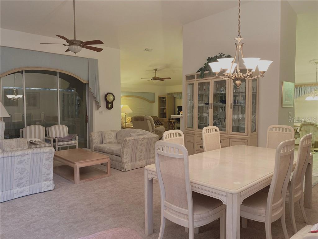 DINING ROOM AND LIVING ROOM - Single Family Home for sale at 7036 S Lake Dr, Englewood, FL 34224 - MLS Number is D6107032