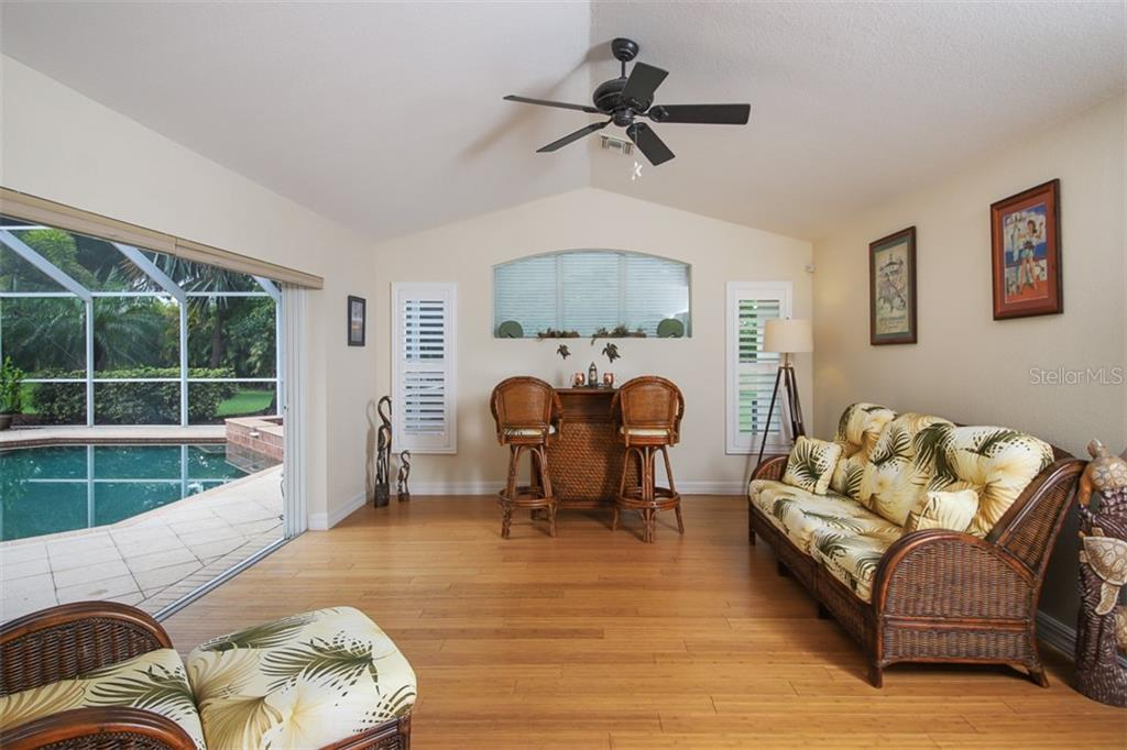 Family Room features bamboo flooring & plantation shutters - Single Family Home for sale at 254 Rotonda Blvd E, Rotonda West, FL 33947 - MLS Number is D6107401