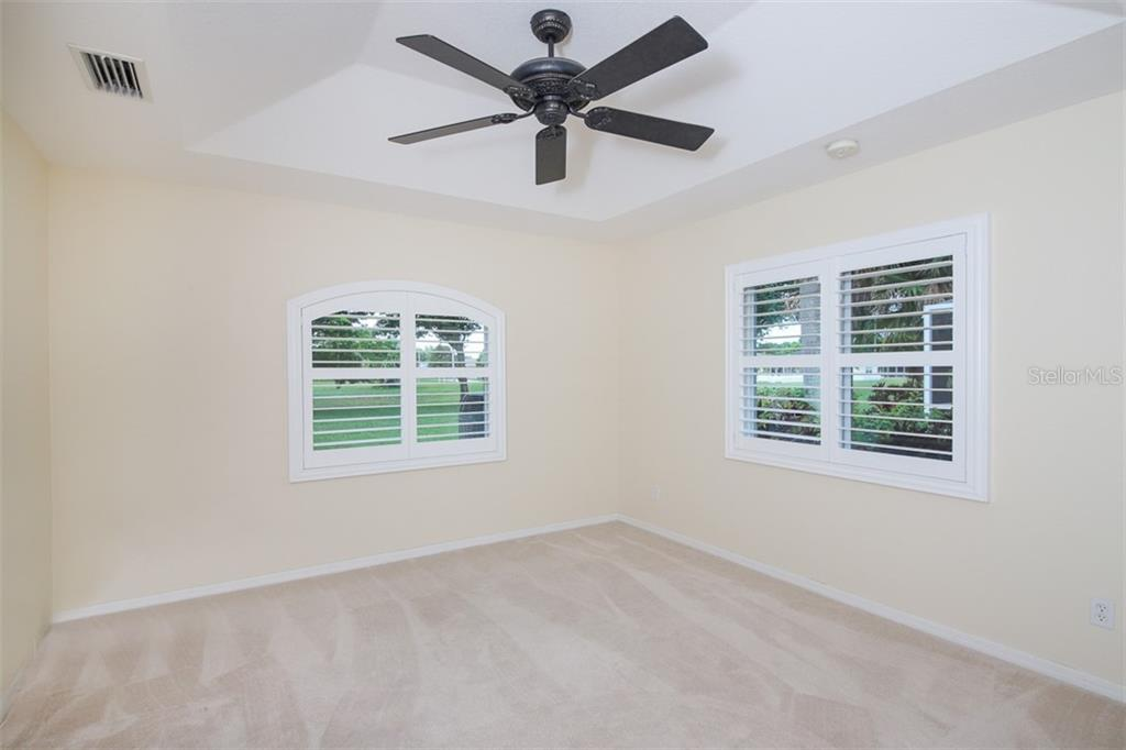 Bedroom #3 has beautiful views overlooking the spacious greenbelt - Single Family Home for sale at 254 Rotonda Blvd E, Rotonda West, FL 33947 - MLS Number is D6107401