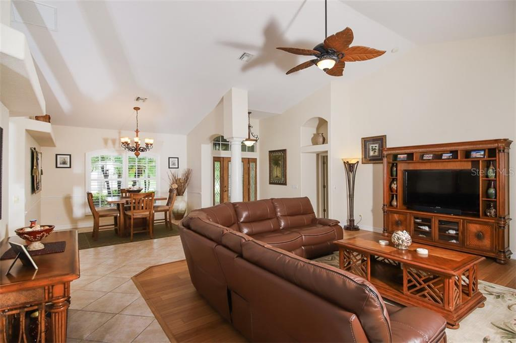 Living Room-Dining Room-Foyer entry - Single Family Home for sale at 254 Rotonda Blvd E, Rotonda West, FL 33947 - MLS Number is D6107401