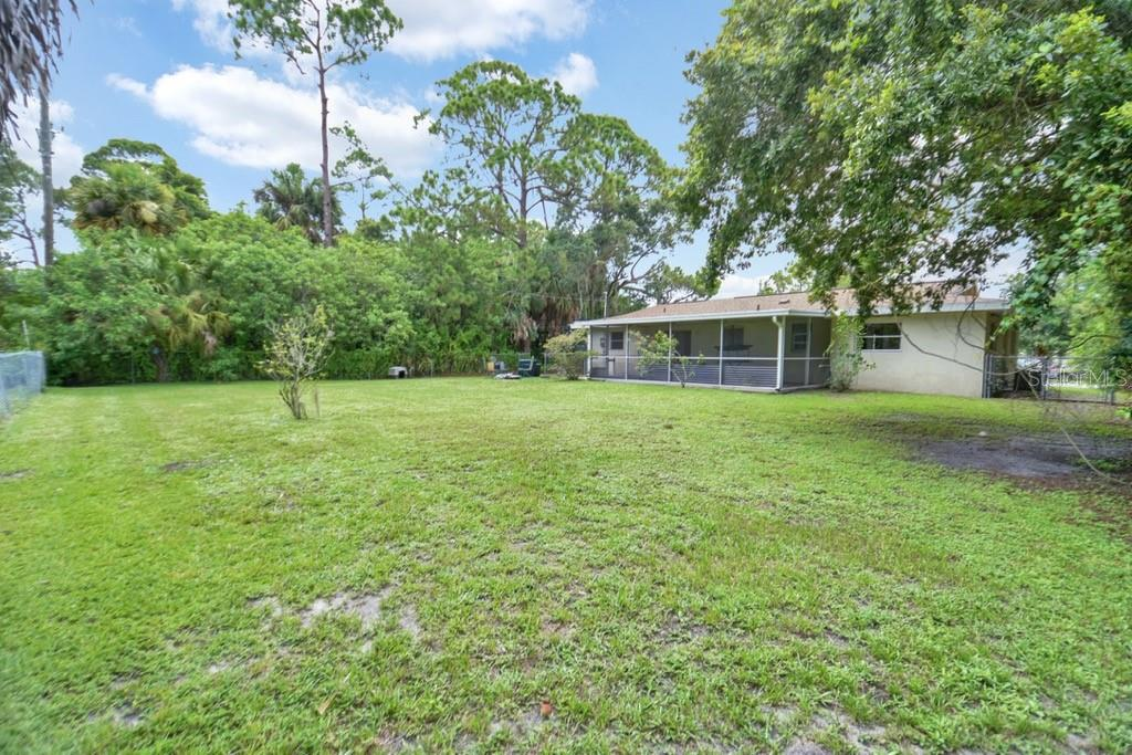 Rear exterior - Single Family Home for sale at 20233 Peachland Blvd, Port Charlotte, FL 33954 - MLS Number is D6107765
