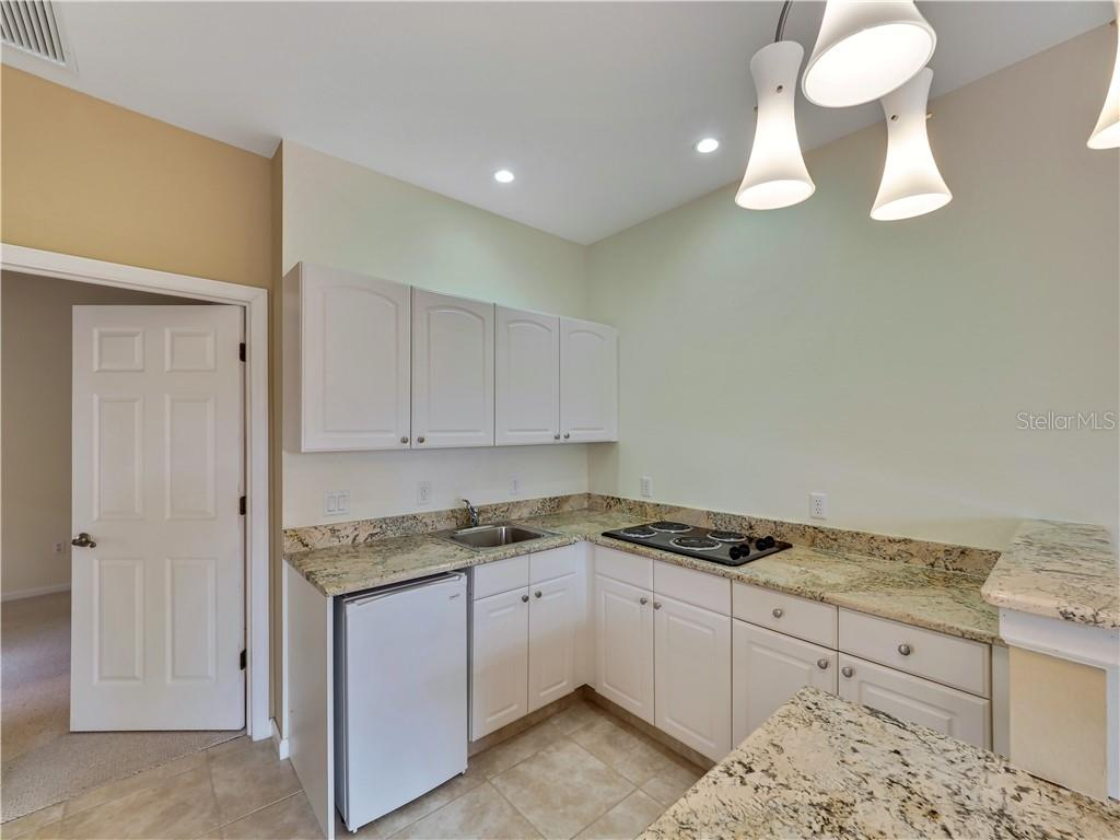 Guest house In-law suite kitchen - Single Family Home for sale at 13283 Eisenhower Dr, Port Charlotte, FL 33953 - MLS Number is D6107998