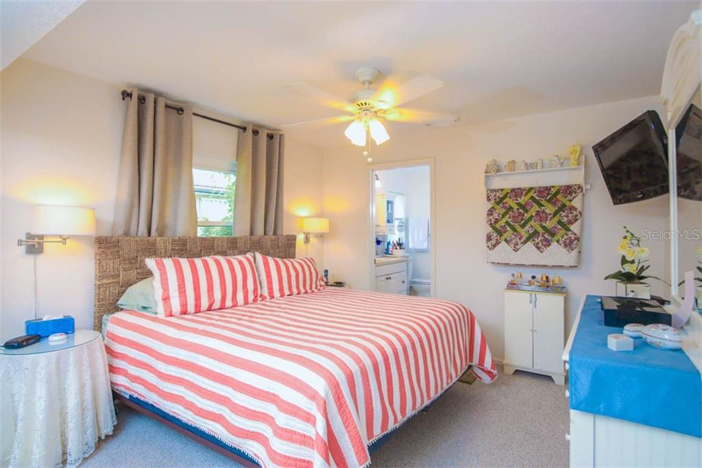 Master bedroom with king size bed - Single Family Home for sale at 913 Tropical Ave Nw, Port Charlotte, FL 33948 - MLS Number is D6108061