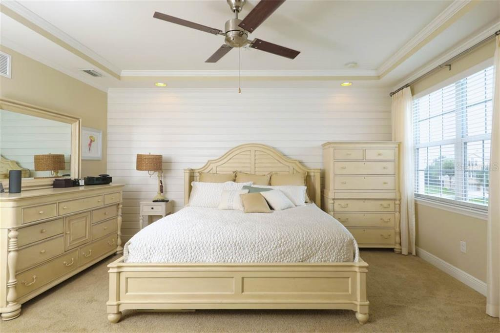 Shiplap accent wall, tray ceiling and crown molding in master - Townhouse for sale at 10335 Longshore Rd #25, Placida, FL 33946 - MLS Number is D6108194