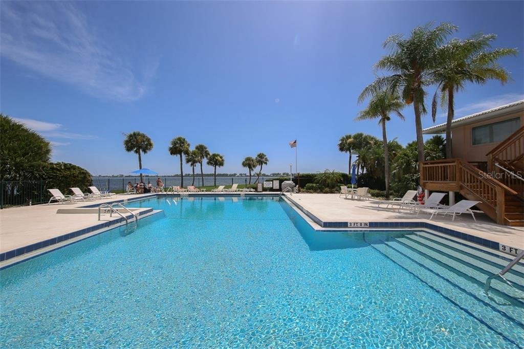 Swim in the sparkling pool while watching the boats cruise by - Condo for sale at 11000 Placida Rd #2301, Placida, FL 33946 - MLS Number is D6108434