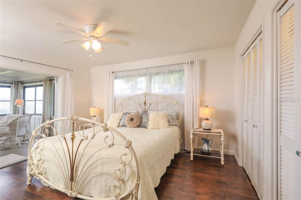 Master Bedroom Opens to Lanai - Single Family Home for sale at 1626 New Point Comfort Rd, Englewood, FL 34223 - MLS Number is D6108454