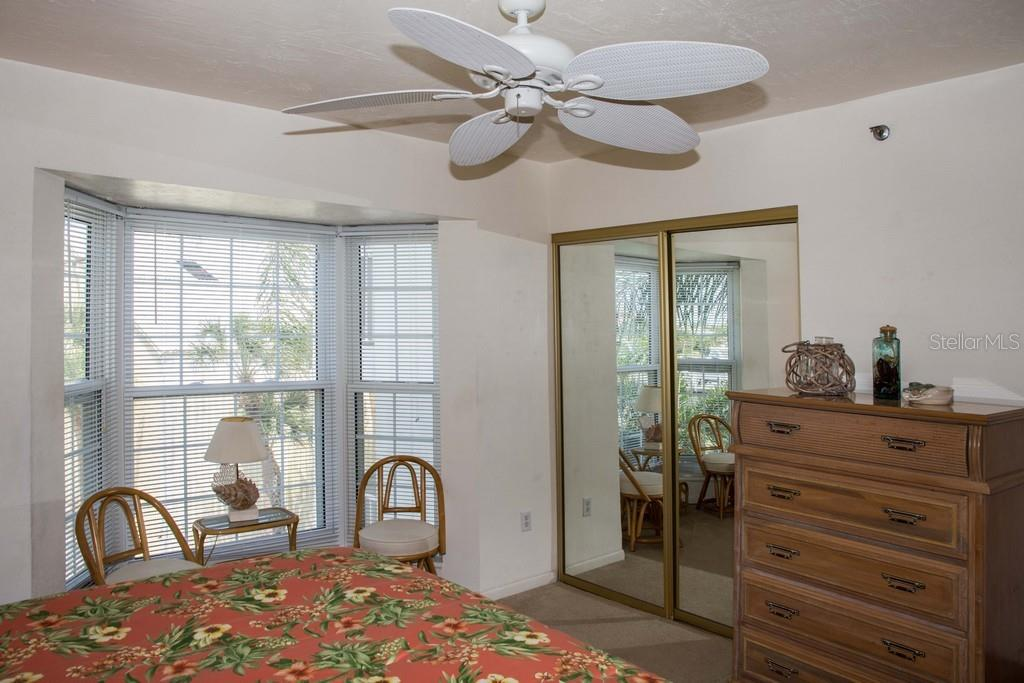 Another view of the master bedroom with large closet. - Condo for sale at 7070 Placida Rd #1223, Placida, FL 33946 - MLS Number is D6108523