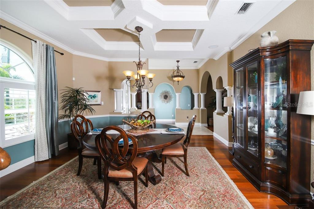 Dining Room complimented by coffered ceilings - Single Family Home for sale at 15052 Aquarius Cir, Port Charlotte, FL 33981 - MLS Number is D6108637