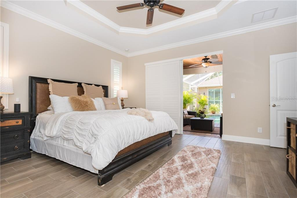 Master Bedroom with Sliding Glass Doors to the Lanai/Pool - Single Family Home for sale at 130 Jade St, Rotonda West, FL 33947 - MLS Number is D6108653