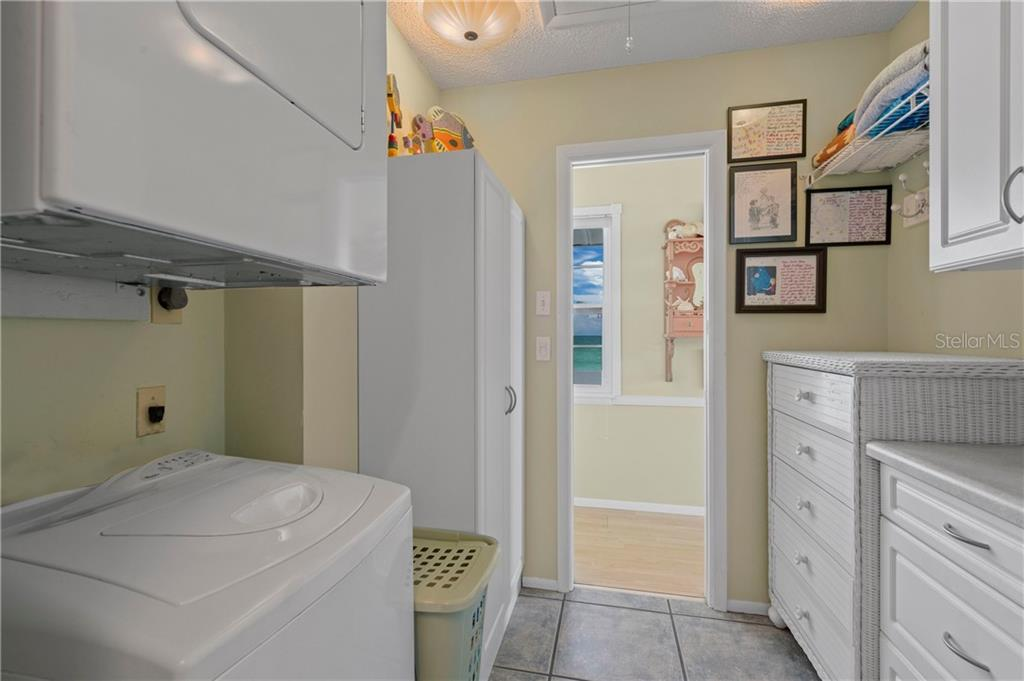 Separate Laundry Room Off Master Bedroom and Bath - Single Family Home for sale at 8 Adele Way, Placida, FL 33946 - MLS Number is D6108747
